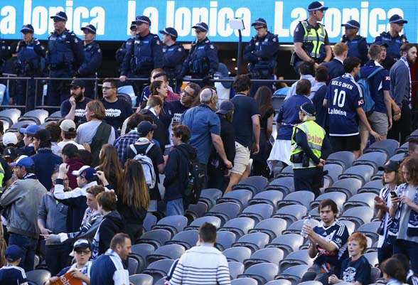 The North Terrace walking out midway through the first half against Adelaide United. (photo by Getty Images)