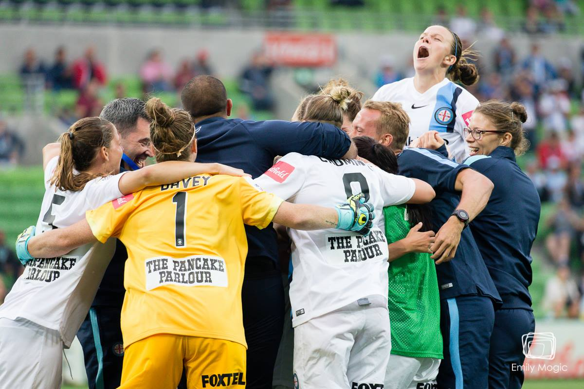 City family celebrates their semi final victory (Photo: Emily Mogic Photography)