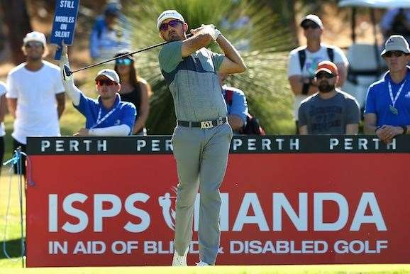 Rhein Gibson watches his tee shot on the 6th hole during the second round. PHOTO: Paul Kane/Getty Images.