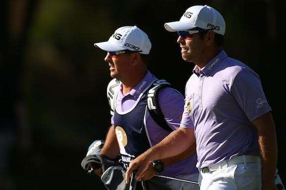Oosthuizen and his caddie walk up the 18th fairway to generous applause. PHOTO: Paul Kane/Getty Images.