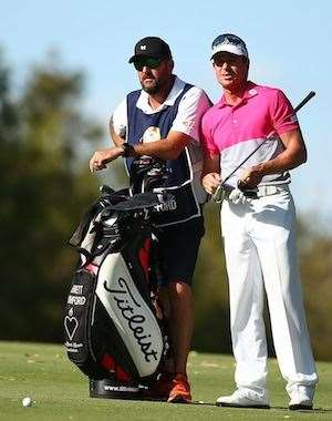 Brett Rumford talks with his caddie before playing his 2nd shot into the 18th hole. PHOTO: Paul Kane/Getty Images