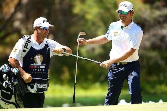 Oosthuizen smiles after chipping close to set up a birdie at the par-5 3rd hole. PHOTO:  Paul Kane/Getty Images.