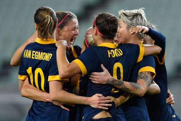 Matildas celebrate after qualification was assured. (Photo by Getty Images)