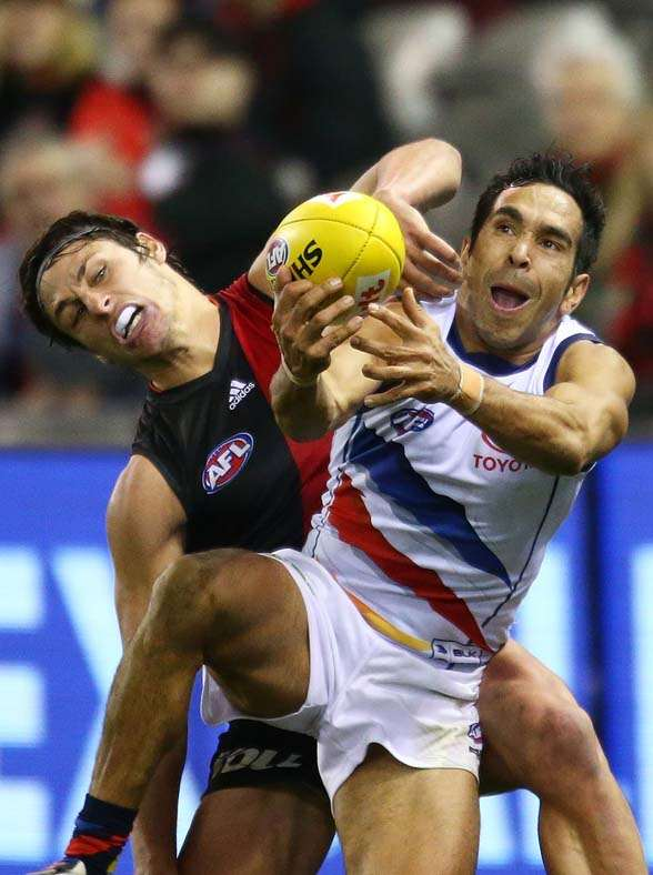 MELBOURNE, AUSTRALIA - AUGUST 15: Eddie Betts of the Adelaide Crows takes a mark in front of Mark Baguley of the Essendon Bombers during the round 20 AFL match between the Essendon Bombers and the Adelaide Crows at Etihad Stadium on August 15, 2015 in Melbourne, Australia. (Photo by Scott Barbour/Getty Images)