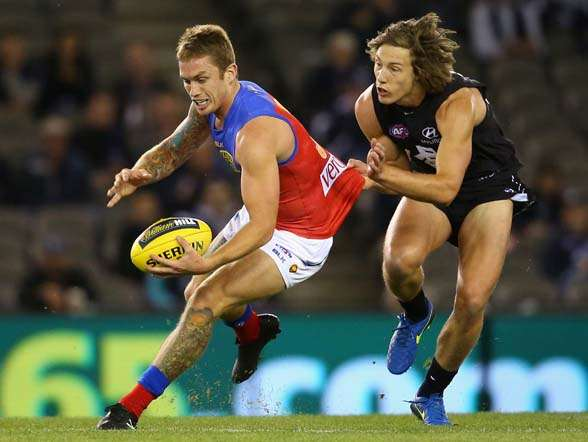 MELBOURNE, AUSTRALIA - MAY 10: Dayne Beams of the Lions is tackled by Mark Whiley of the Blues during the round six AFL match between the Carlton Blues and the Brisbane Lions at Etihad Stadium on May 10, 2015 in Melbourne, Australia. (Photo by Quinn Rooney/Getty Images)