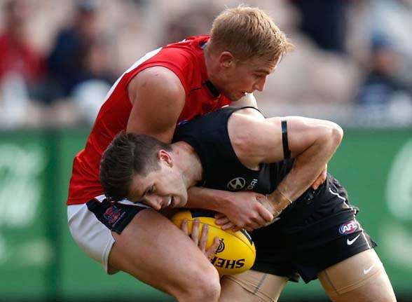 MELBOURNE, AUSTRALIA - AUGUST 23: Marc Murphy of the Blues is tackled by Bernie Vince of the Demons during the 2015 AFL round 21 match between the Carlton Blues and the Melbourne Demons at the Melbourne Cricket Ground, Melbourne, Australia on August 23, 2015. (Photo by Michael Willson/AFL Media/Getty Images)