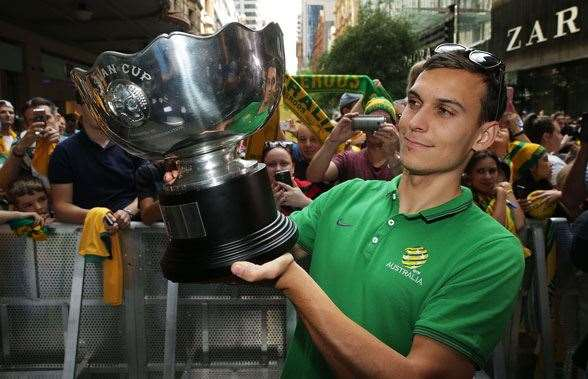 Trent Sainsbury holding the Asian Cup - now with Jiangsu Suning. (Photo by Getty Images)