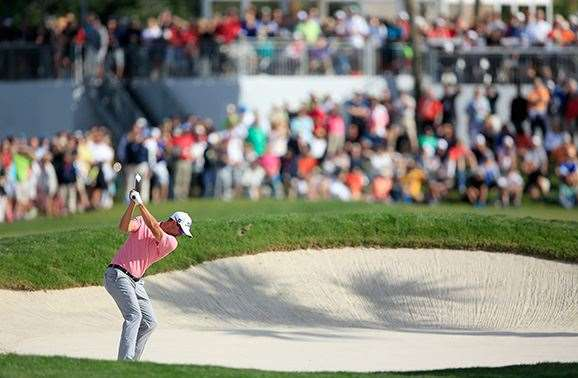 Scott fires his second shot into the par-4, 12th hole en route to victory. PHOTO: David Cannon/Getty Images.
