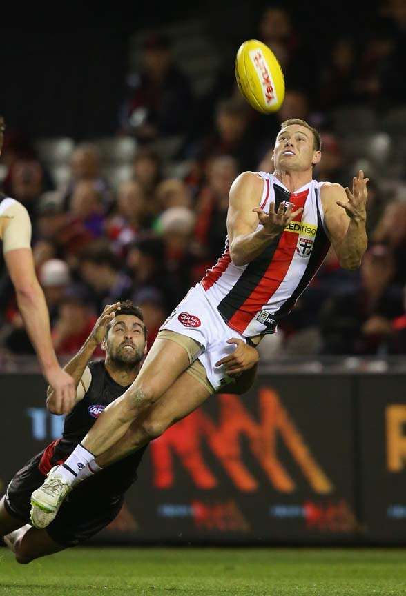 MELBOURNE, AUSTRALIA - JULY 05: David Armitage of the Saints marks infront of Courtenay Dempsey of the Bombers during the round 14 AFL match between the Essendon Bombers and the St Kilda Saints at Etihad Stadium on July 5, 2015 in Melbourne, Australia. (Photo by Quinn Rooney/Getty Images)