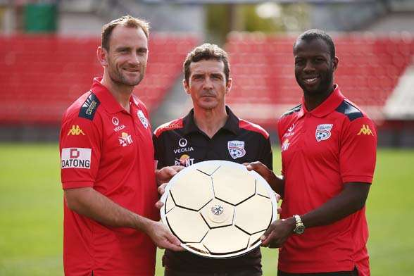 Eugene Galekovic, Guillermo Amor and Bruce Djite receive the A-League Premiers Plate. (Photo by Getty Images).