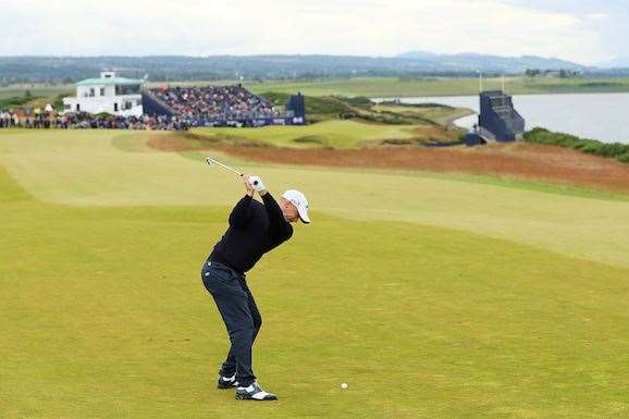 Noren fires his approach into the 18th hole en route to victory. PHOTO: Andrew Redington/Getty Images.