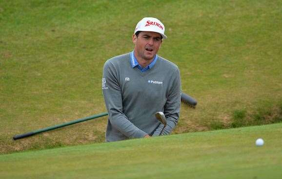 Former PGA Champion Keegan Bradley struggles to get out of a greenside bunker on the 8th hole during practice yesterday. PHOTO: Glyn Kirk/AFP/Getty Images.
