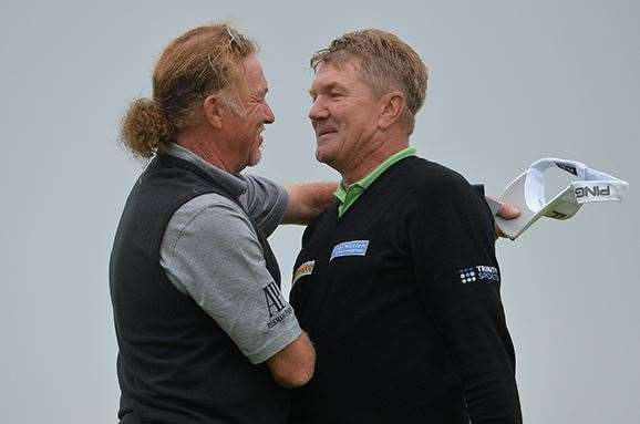 Broadhurst is embraced by playing partner Miguel Angel Jimenez, who let his chances of victory slip during the final round. PHOTO: Mark Runnacles/Getty Images.