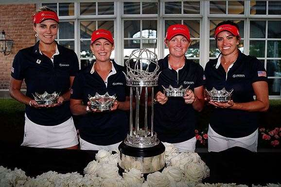Lexi Thompson, Cristie Kerr, Stacy Lewis and Gerina Piller pose with the champions trophy after winning the 2016 UL International Crown. PHOTO: Matt Sullivan/Getty Images.