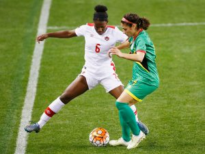 HOUSTON, TX - FEBRUARY 11: Deanne Rose #6 of Canada battles for the ball with Kayla De Souza#4 of Guyana during the 2016 CONCACAF Women's Olympic Qualifying at BBVA Compass Stadium on February 11, 2016 in Houston, Texas. (Photo by Scott Halleran/Getty Images)
