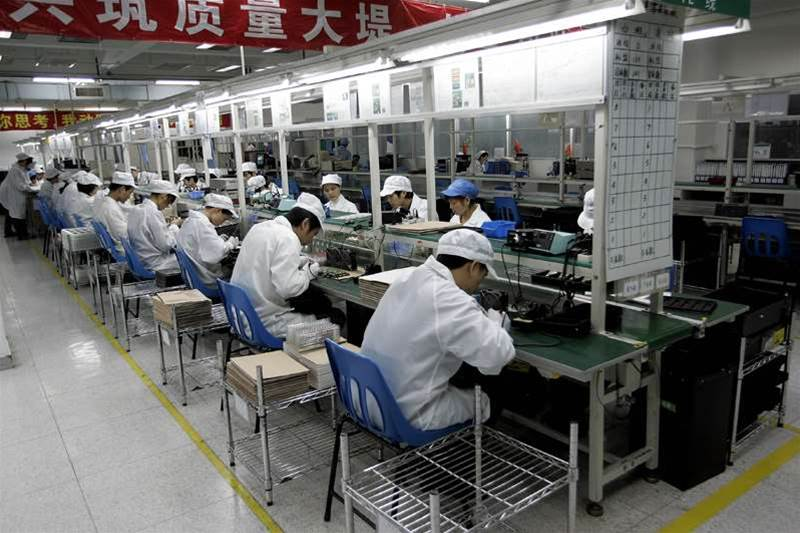 Image result for Workers on a tech production line in China. Pic: AFP