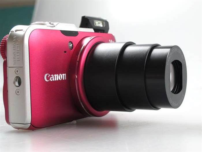 The $499 PowerShot SX230 HS. Big zoom, small camera. Also, the first Canon digital camera with built-in GPS tagging.