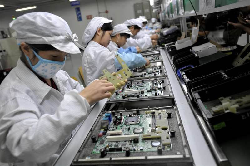 In a picture taken on May 26, 2010 Chinese workers assemble electronic components at the Taiwanese technology giant Foxconn's factory in Shenzhen, in the southern Guangzhou province. Foxconn on June 2 confirmed the death of another employee but denied he died of exhaustion following a spate of suicides at its Chinese plants. AFP/AFP/Getty Images