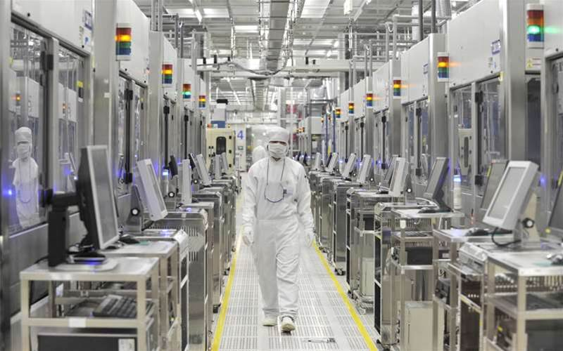 An employee of Japan's microprocessor maker Renesas Electronics works at the company's Naka wafer fabrication factory in Hitachinaka, Ibaraki prefecture on June 10, 2011. Renesas Electronics, a key microprocessor maker, said June 10 it would restore supply capacity to pre-March 11 earthquake levels by late September, a month earlier than planned. KAZUHIRO NOGI/AFP/Getty Images