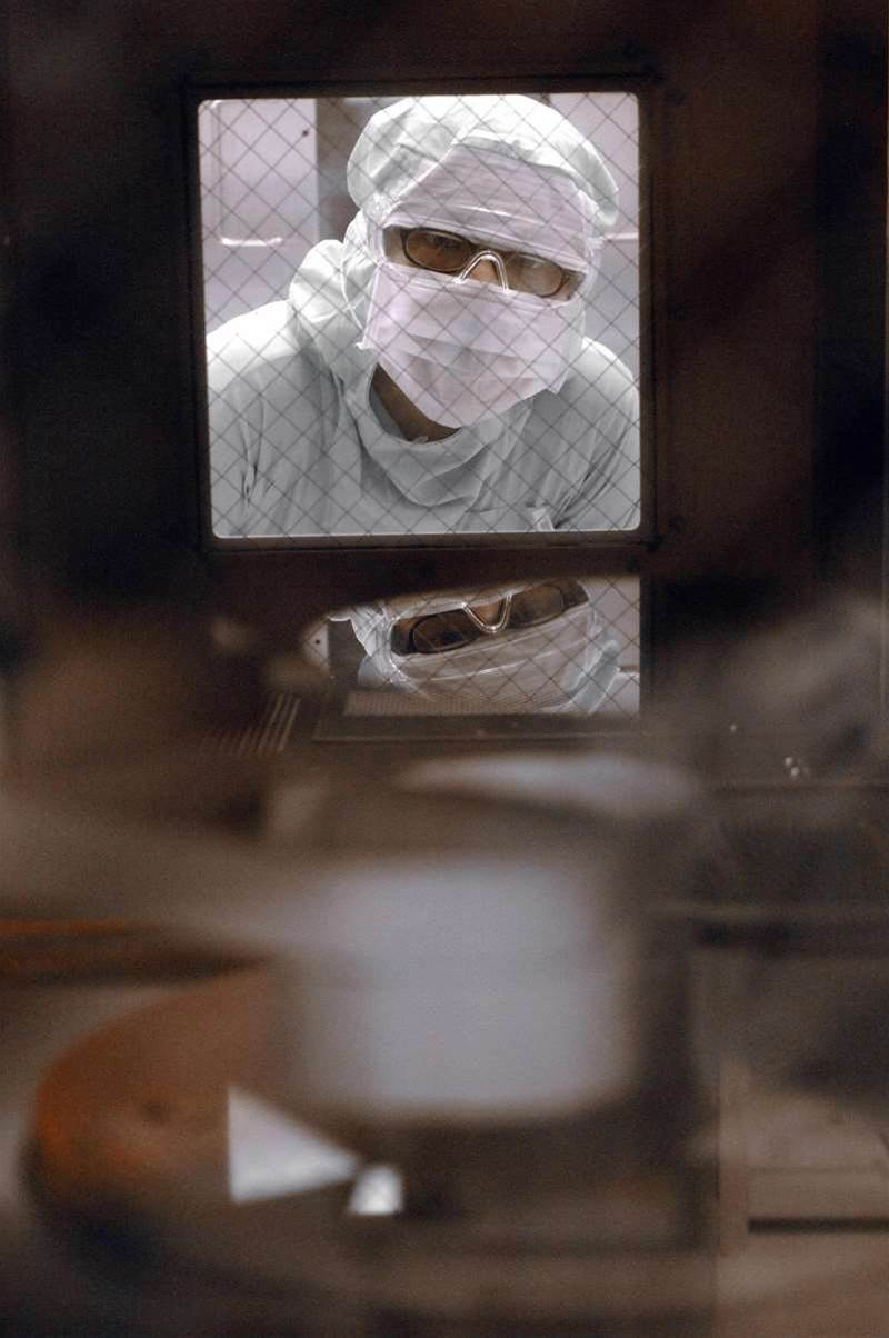 An engineer of United Microelectronics Corp (UMC) checks a wafer inside a machine at the company's wafer factory in Tainan Science Park, southern Taiwan, 28 April 2006. UMC, the world's second largest contract microchip maker, said 26 April its net earnings in the first quarter in 2006 rose sharply due to higher non-operating income. UMC is a world-leading semiconductor foundry, specializing in the contract manufacturing of customer designed ICs for high performance semiconductor applications. SAM YEH/AFP/Getty Images