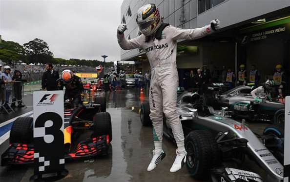 Hamilton reigns in the rain