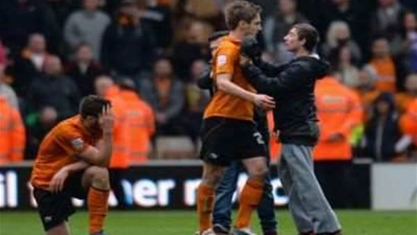 Wolves target action against pitch invaders