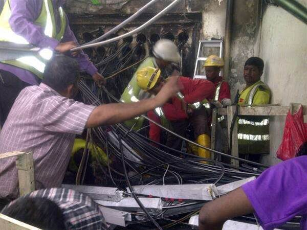 SingTel engineers work to recover from exchange fire