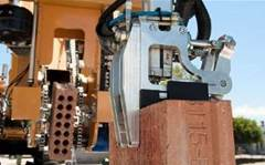 This robot lays 1,000 bricks an hour and can build a house in two days