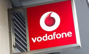 Vodafone halves loss in first half