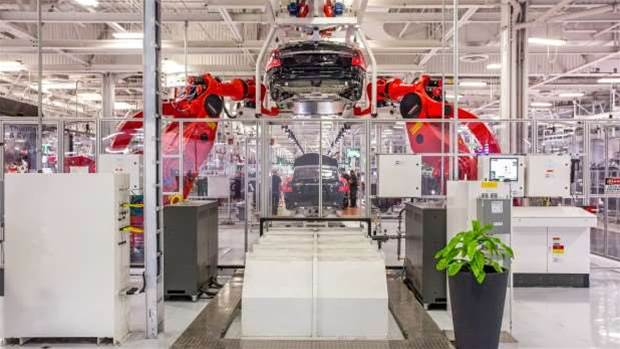Behind the scenes of Tesla's huge car factory