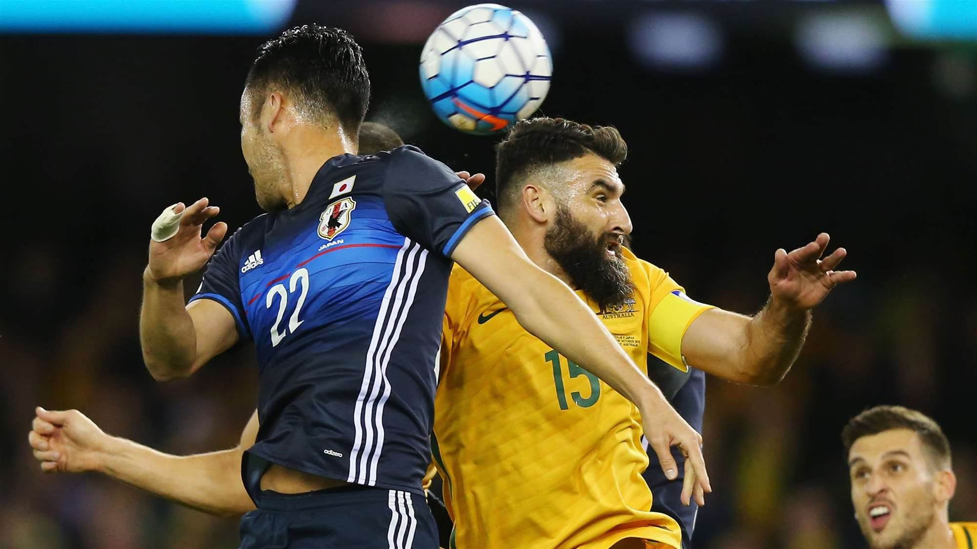 Slow start Socceroos salvage draw with Japan