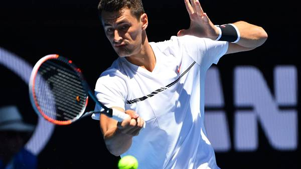 Tomic storms into second round at Aussie Open
