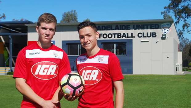 Reds promote teen duo