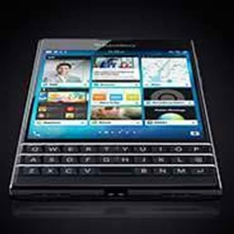 BlackBerry cuts loss, sales rise