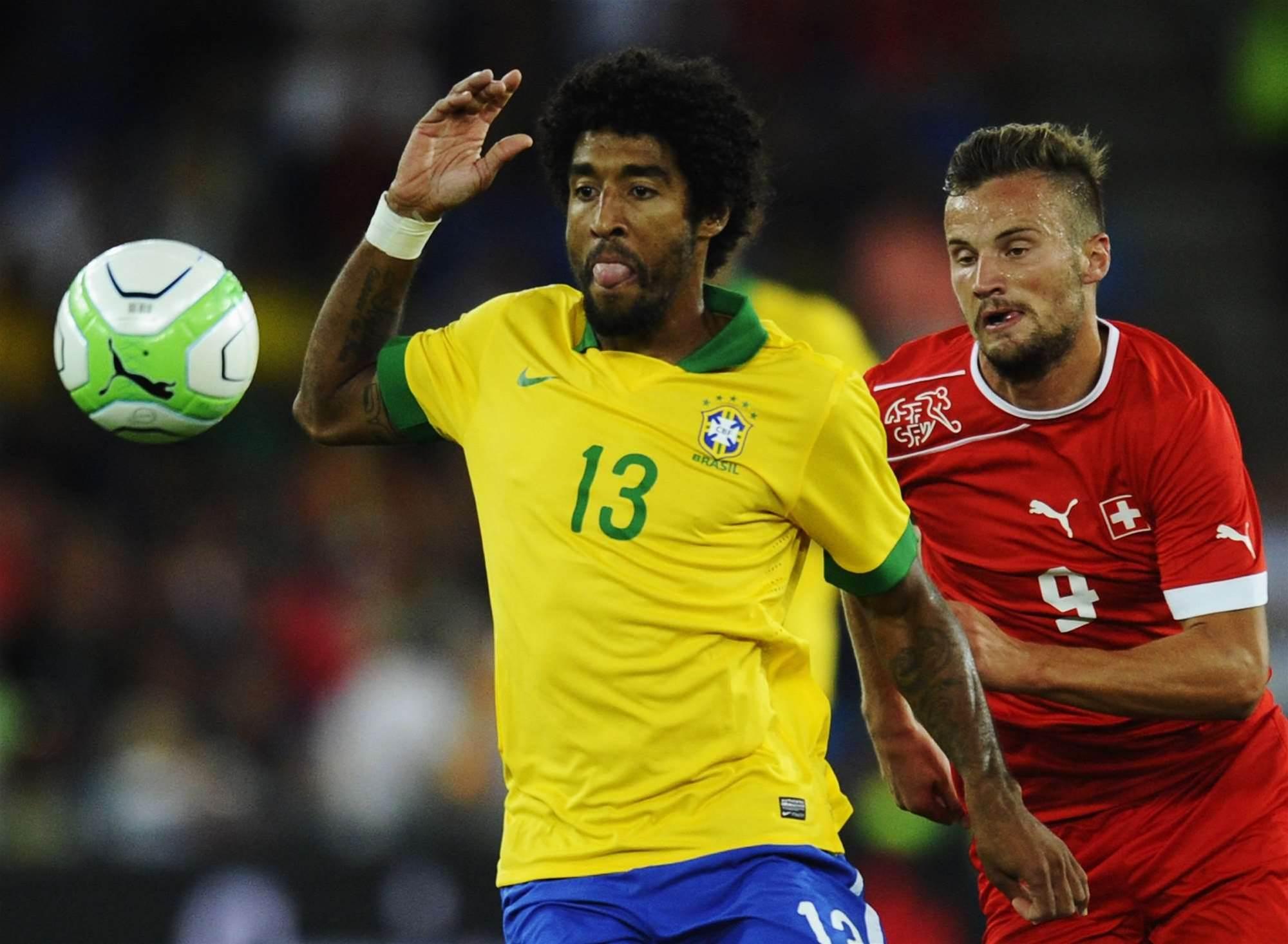 International Wrap: Brazil stunned, Germany held, Spain win