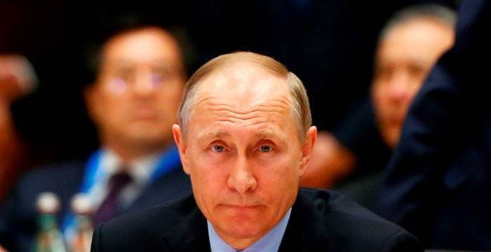 Putin talks fondly of 'free spirited' hackers, denies interference