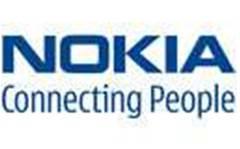 Nokia cuts losses, beats sales estimates