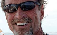 On the run: McAfee founder wanted for murder
