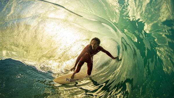 THE SURFBOARD  GOES GREEN