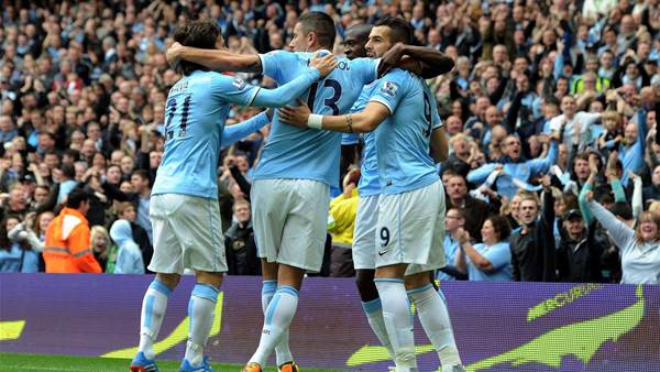 Manchester City surge back into top four