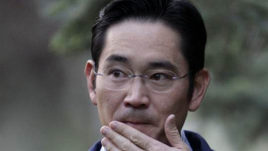 Samsung boss spends first night in a cell