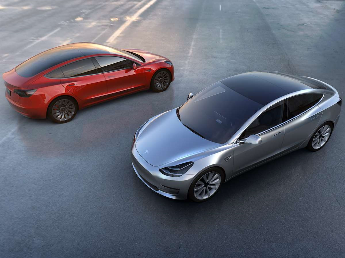Tesla's record-breaking Model 3 sparks into action with 325,000 pre-orders - will you switch to electric, too?