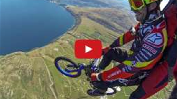 .... and he rode out of it! Skydiving over Queenstown with a bike.