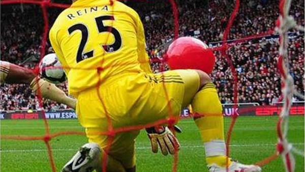 Freak Bent Goal Sinks Liverpool