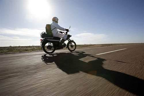 Bike tech: Daredevil duo drive postage bike 3000km fuelled by alcohol