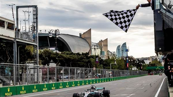 Hamilton inherits win in incident-packed Baku GP