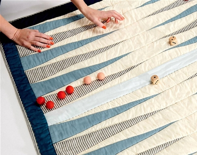 a cosy quilt and board game all in one