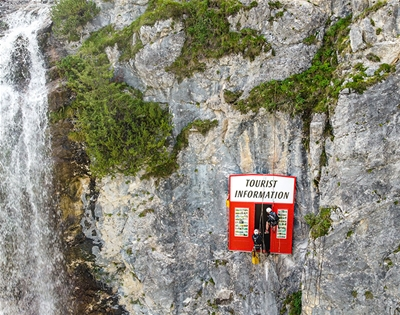 artists installed a tourist information booth on a cliff face