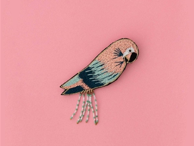 a flock of bird brooches