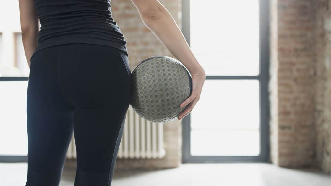 This 15-minute ball workout will slim your thighs fast